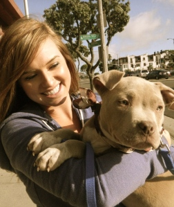 Holding a Pit Bull Puppy of Bullies and Buddies Rescue